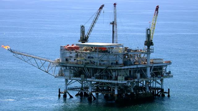Aerial shot of off shore oil platform video