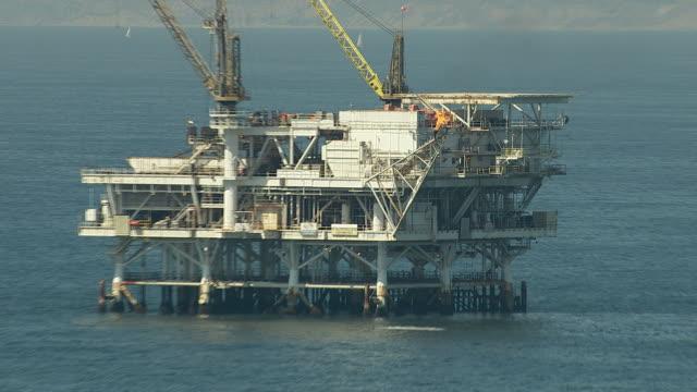 Aerial shot of off shore oil platforms video