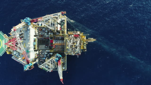 Aerial shot of off shore oil platforms working close up day time off shore working close up oil stock videos & royalty-free footage