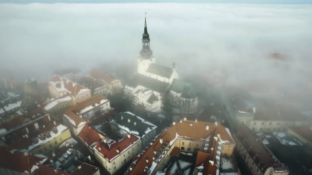 aerial shot of old town on a foggy winter day. churches spires are beautifully visible. - medieval architecture stock videos & royalty-free footage