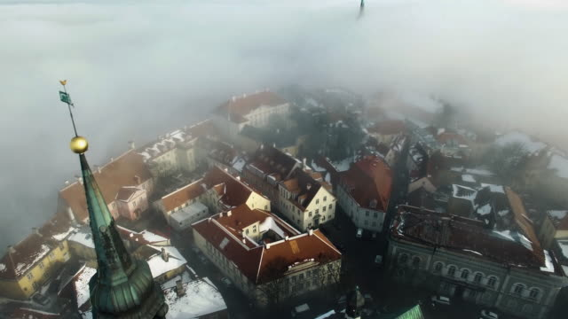aerial shot of old town on a winter day. it's foggy but old fortress and historical buildings are visible. - medieval architecture stock videos & royalty-free footage