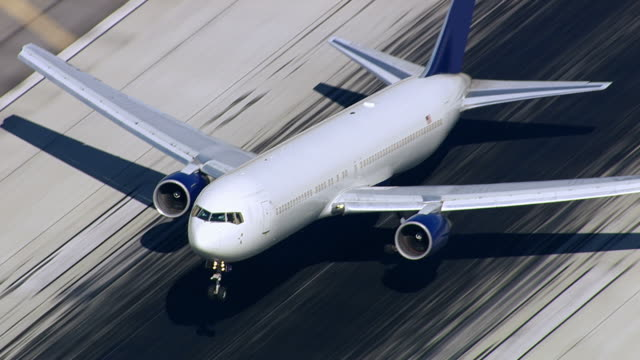Aerial shot of passenger jet landing on runway video