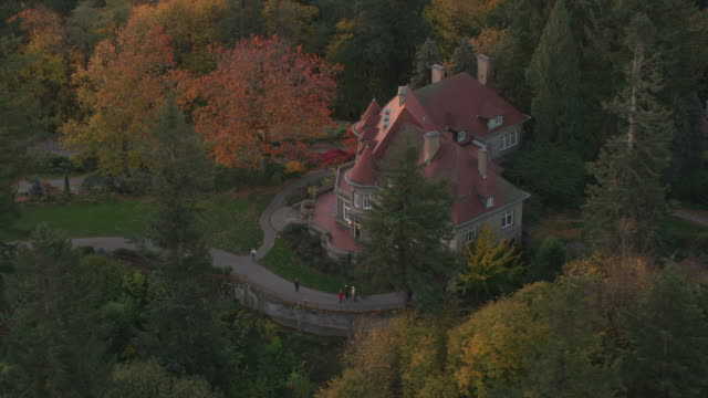 Aerial shot of Pittock Mansion in Fall. Portland, Oregon circa-2017, Aerial shot of Pittock Mansion in Fall.  Shot with Cineflex and RED Epic-W Helium. mansion stock videos & royalty-free footage