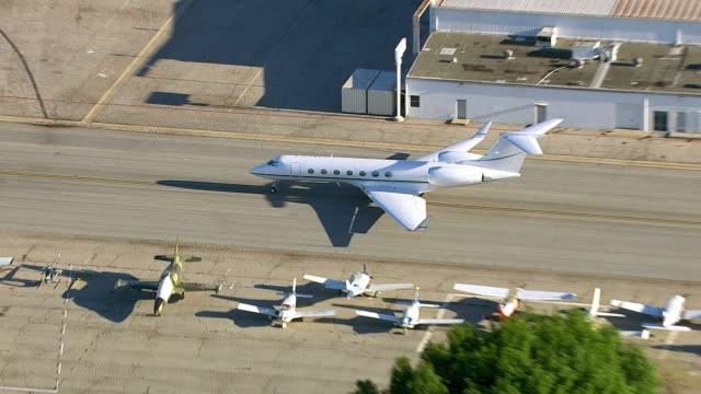 Aerial shot of private jet on airport runway video