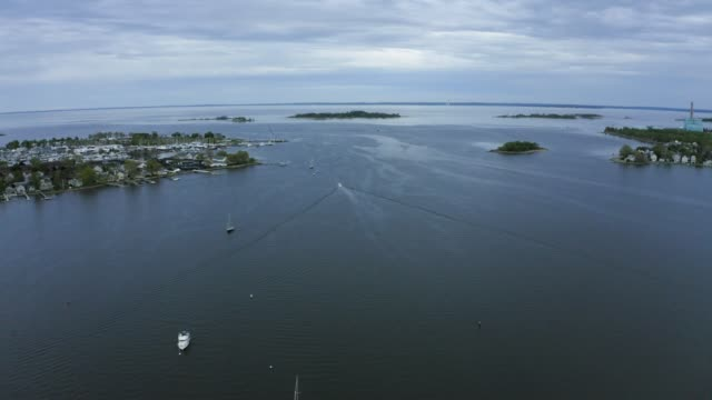Aerial Shot of Quiet Harbor with Boats Going in and Out (Norwalk, Connecticut) Shot on DJI Mavic 2 Pro on May 11, 2019 connecticut stock videos & royalty-free footage