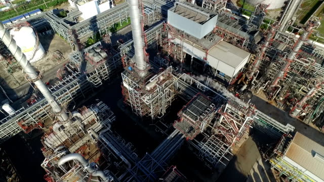Aerial shot of refinery with smoke stacks video