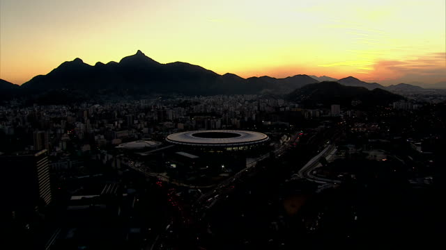 Aerial shot of Rio de Janeiro, Brazil at night HD 1080P: Aerial view of Maracana Stadium and city lights at night, Rio de Janeiro, Brazil.  Shot with cineflex gyro-stabilized camera system. brazil stock videos & royalty-free footage