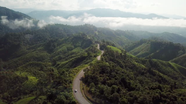 aerial shot of road in the mountain , driving concept - passo montano video stock e b–roll