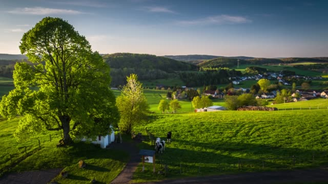 Video Aerial shot of rural landscape with fields and villages in Germany