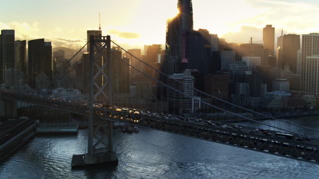 Aerial Shot of San Francisco Embarcadero and Financial District Behind the Bay Bridge