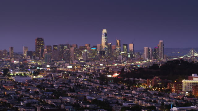 Aerial Shot of San Francisco Financial District and the Bay Bridge at Twilight