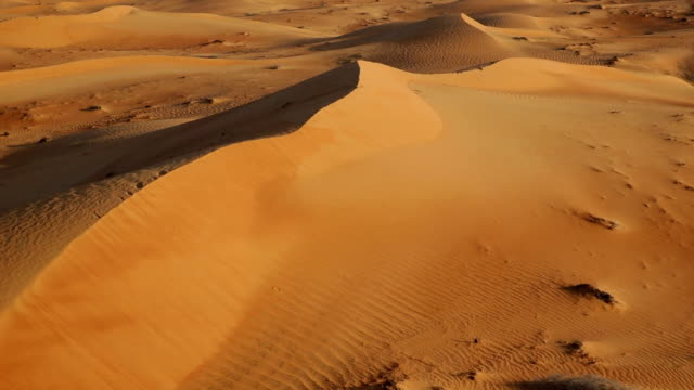 Aerial shot of sand dunes at sunrise, Dubai, UAE video