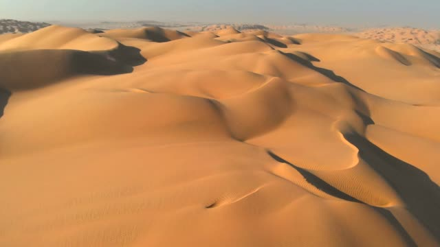 Aerial shot of sand dunes in Arabian Desert - Empty quarter in Oman. 4K, UHD Aerial shot of sand dunes in Arabian Desert - Empty quarter in Oman. 4K, UHD eternity stock videos & royalty-free footage