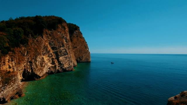 Aerial shot of sea waves and cliff. Sveti Nikola Island rock coast drone footage Aerial shot of sea waves and cliff. Sveti Nikola Island rock coast drone footage 4K UHD big island hawaii islands stock videos & royalty-free footage