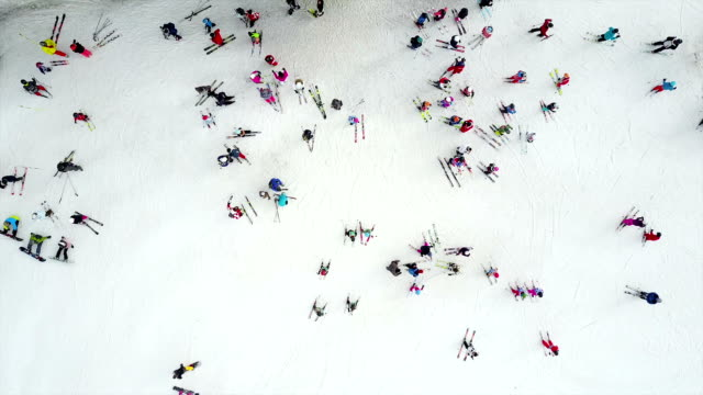 aerial shot of skiers preparing to ski - sci video stock e b–roll