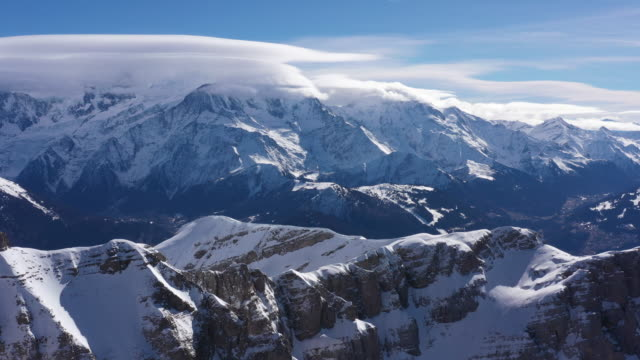 aerial shot of snow covered grand massif and mont blanc - monte bianco video stock e b–roll