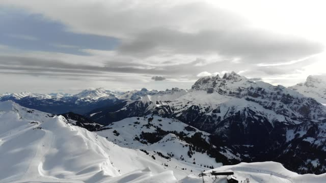 HD Aerial shot of snow covered mountains and ski lift. video