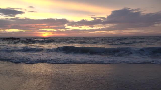 antenn skott av sunrising på havet horisonten - pink sunrise bildbanksvideor och videomaterial från bakom kulisserna