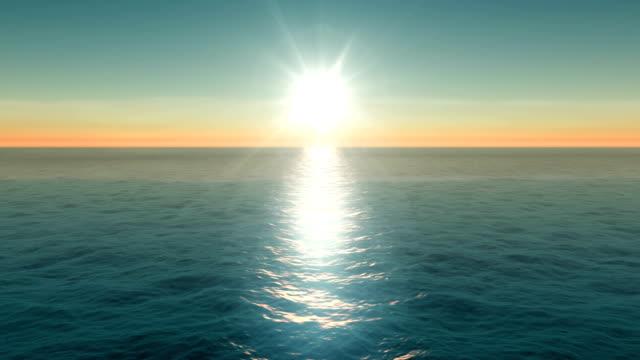 zdjęcie z lotu ptaka zachodu słońca nad spokojną wodą oceaniczną - horyzont wodny filmów i materiałów b-roll