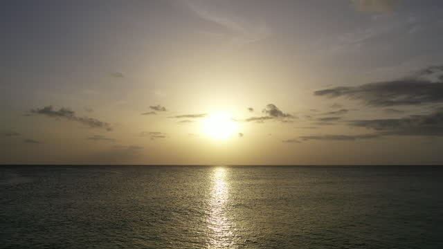 Aerial shot of sunset over calm sea video