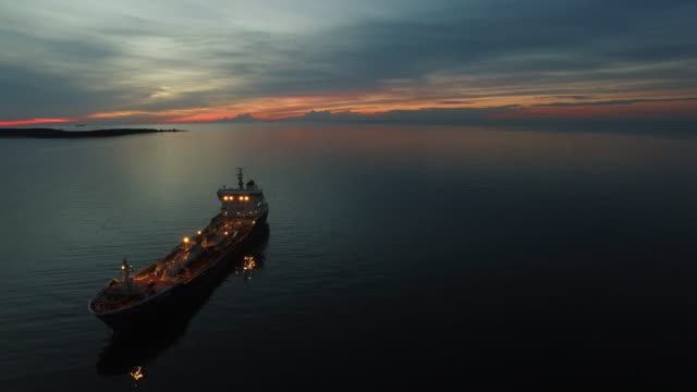 Aerial Shot of Tanker Ship Moving in Sea at Night video