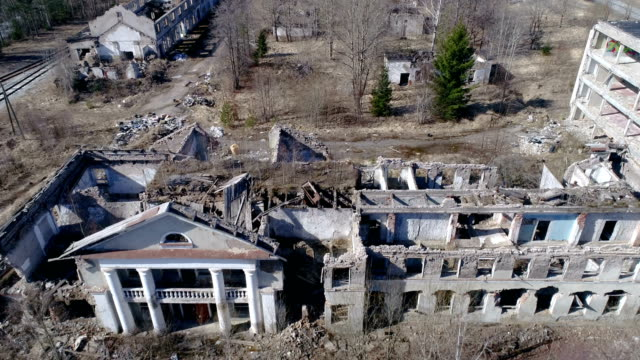 Aerial shot of the big house ruined from the war video