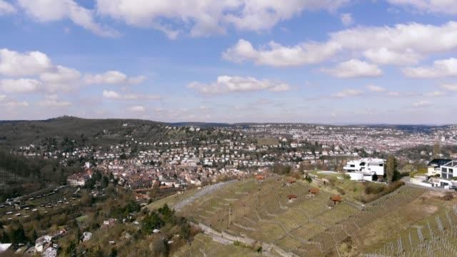 aerial shot of the city from stuttgart - jesus christ filmów i materiałów b-roll