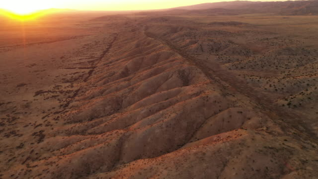 aerial shot of the san andreas fault to the north west of los angeles - rock formations stock videos & royalty-free footage