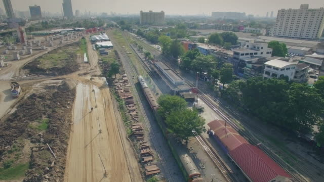 Aerial shot of train arriving to the station video