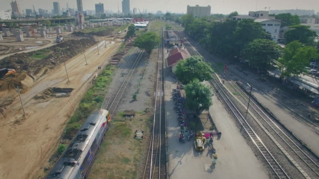 Aerial shot of train arriving to the station,4K video