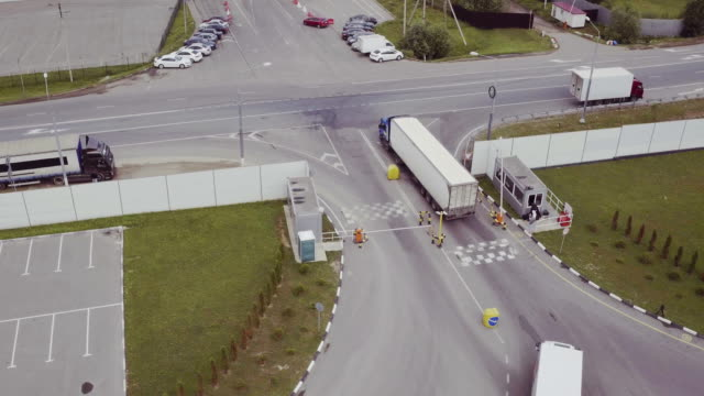 Aerial Shot of Truck with Attached Semi Trailer Leaving Warehouse complex video