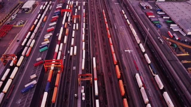 Aerial Shot of Trucks and Trains in Intermodal Rail Yard video