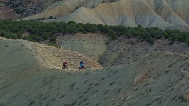 Aerial Shot of Two Mountain Bikers Riding Along a Ridge on 18 Road in Fruita, Colorado