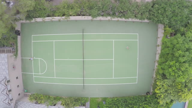 Aerial Shot of Two People Playing Tennis video