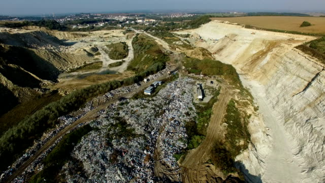Aerial shot of vehicle bringing garbage to dump video