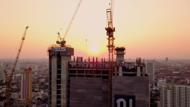 Aerial shot of working construction site with sunset
