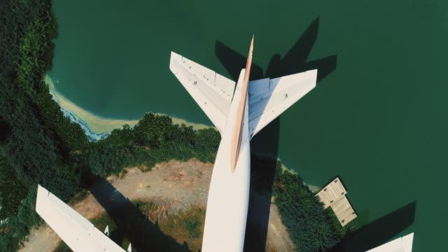 4k aerial shot old plane wreckage on the top view shot by drone - skrzydło samolotu filmów i materiałów b-roll