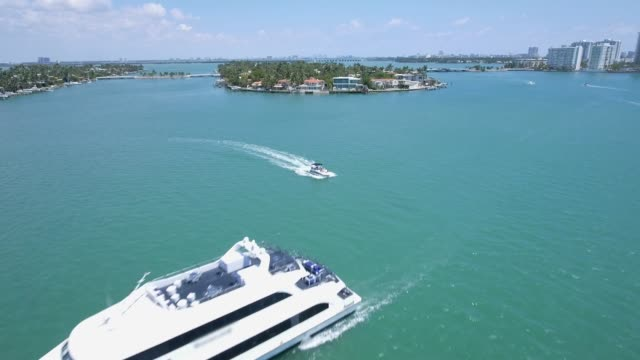 Aerial shot over a Yacht in Miami on a beautiful day