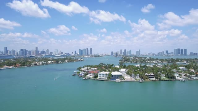 Aerial shot over beautiful homes by the water in Miami, Florida video