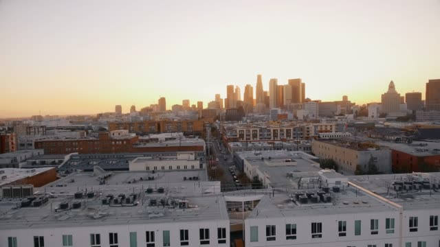 Aerial shot over buildings in Downtown Los Angeles during sunset video