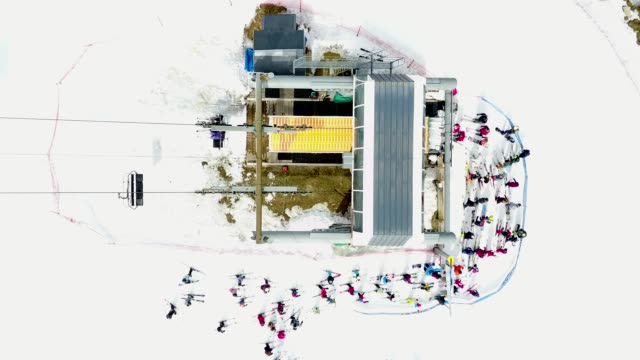 Aerial shot over busy ski lift