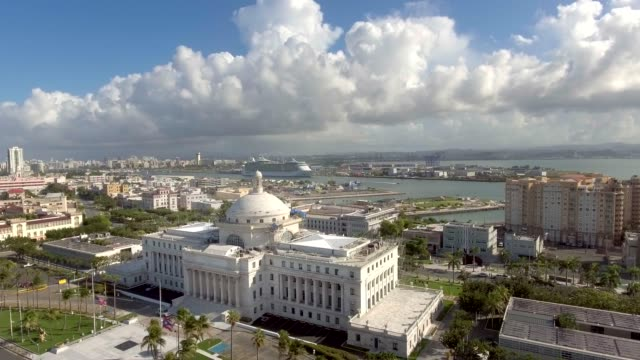 Aerial shot over El Capitolio in San Juan, Puerto Rico Daytime aerial pan shot of the capitol building in San Juan, Puerto Rico and its surroundings puerto rico stock videos & royalty-free footage