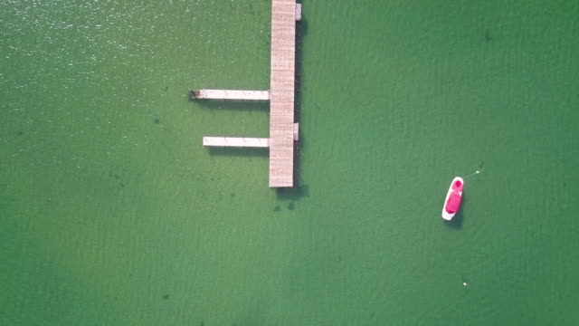 Aerial Shot Pulling Up from Pier on Lake Tahoe video