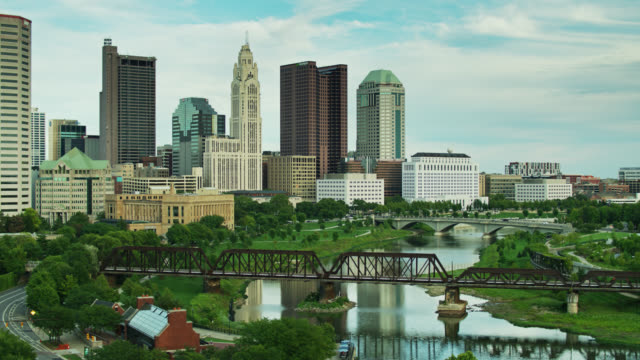 aerial shot revealing downtown columbus skyline - columbus day filmów i materiałów b-roll