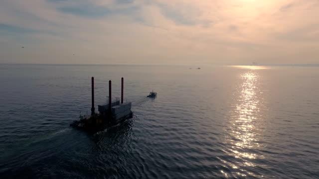 Aerial Shot: Tug Pulling the Platform on the Sea video