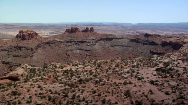 aerial shots of red rock desert buttes and sage desert video