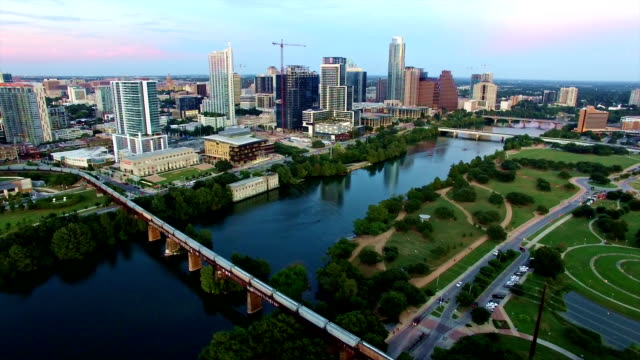 Aerial: Side Pan Across Austin Texas Iconic Downtown Skyline Cityscape at Sunset Aerial: Side Pan Across Austin Texas Iconic Downtown Skyline Cityscape at Sunset post modern architecture stock videos & royalty-free footage