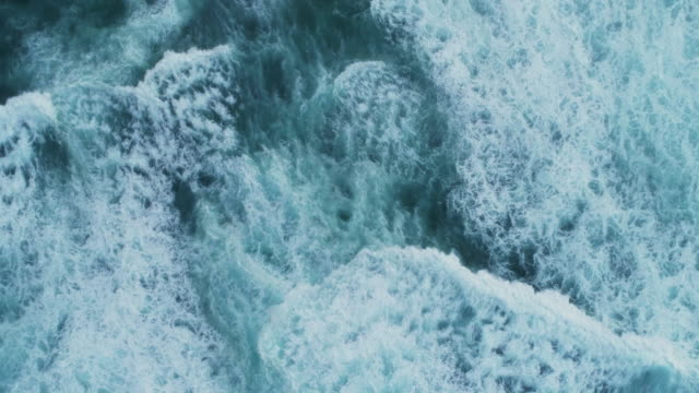 aerial slow motion footage of sea waves and white foam - gommapiuma video stock e b–roll