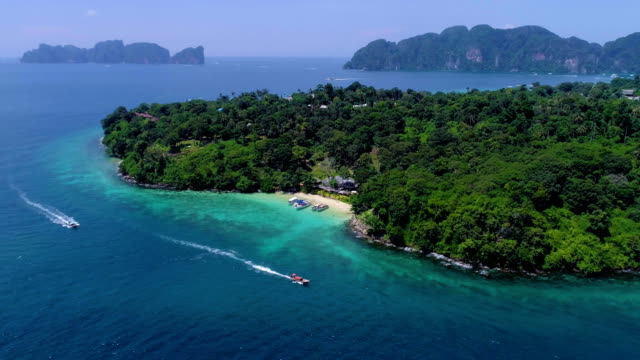 aerial: small beautifil beach with boats on phi phi islands. - phuket video stock e b–roll