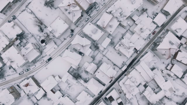 Aerial - Snowy roofs from above video